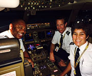 Capt. Wayne Lane ('74, DB);  First Officer Doug Carpenter ('85, PC); and (front) First Officer Dani Johnson (DB, '90)