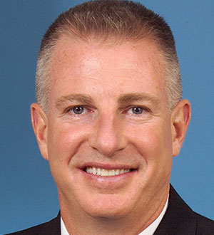 "Retired U.S. Navy Cmdr. John ""J.C."" Coffey ('94, WW)"